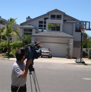 KUSI Channel 9/51 News cameraman photographing Duke Cunningham's old Del Mar Heights Home